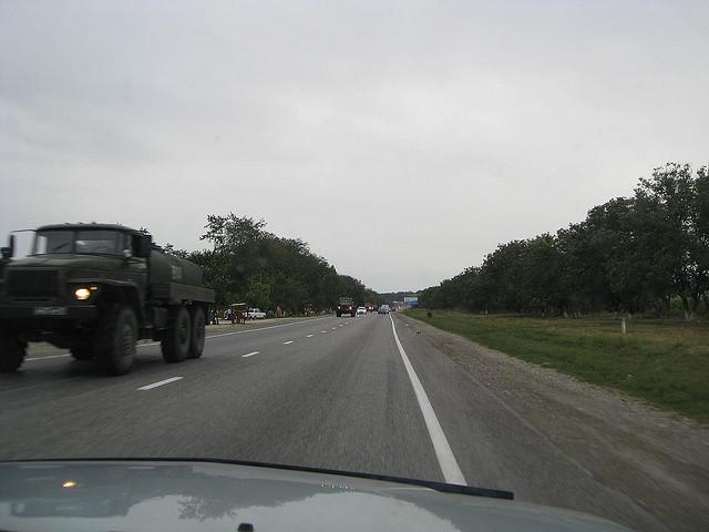 Russian military trucks leaving Georgia. August 2008.