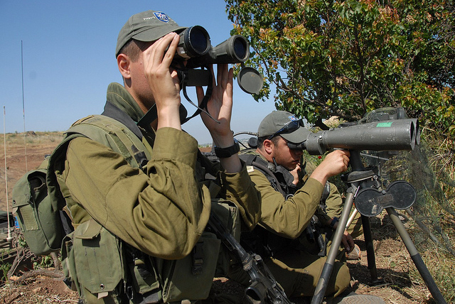 Israeli troops scan the border with Syria.