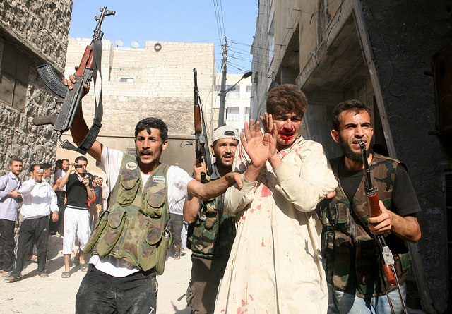 Free Syrian Army rebels with captive. Aleppo, 2012.