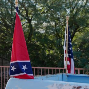 Photo of American and Confederate flags on a pickup truck by Charlie Bertsch