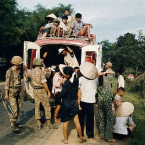 South Vietnamese troops search a truck loaded with fleeing refugees.Hue, 1972.