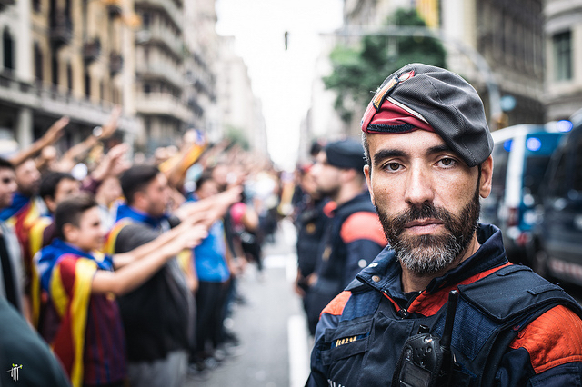 Catalan police officer and protestors. Barcelona, October 2017.
