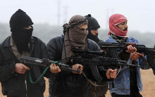 Members of the Free Syrian Army attend a weapons training session outside Idlib, Syria, Tuesday, Feb. 7, 2012.
